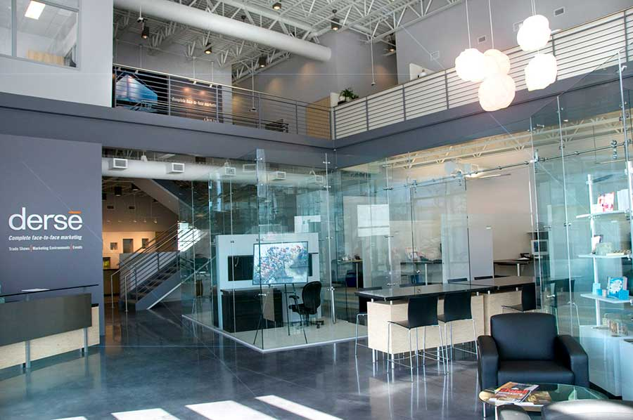 Glass Office Expanding on Fishbowl Workspaces