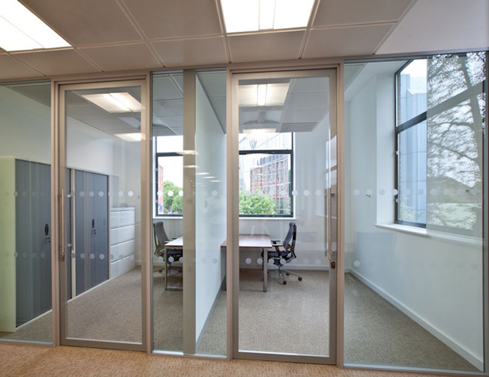 Floor to ceiling glass partitions paired with a glass door
