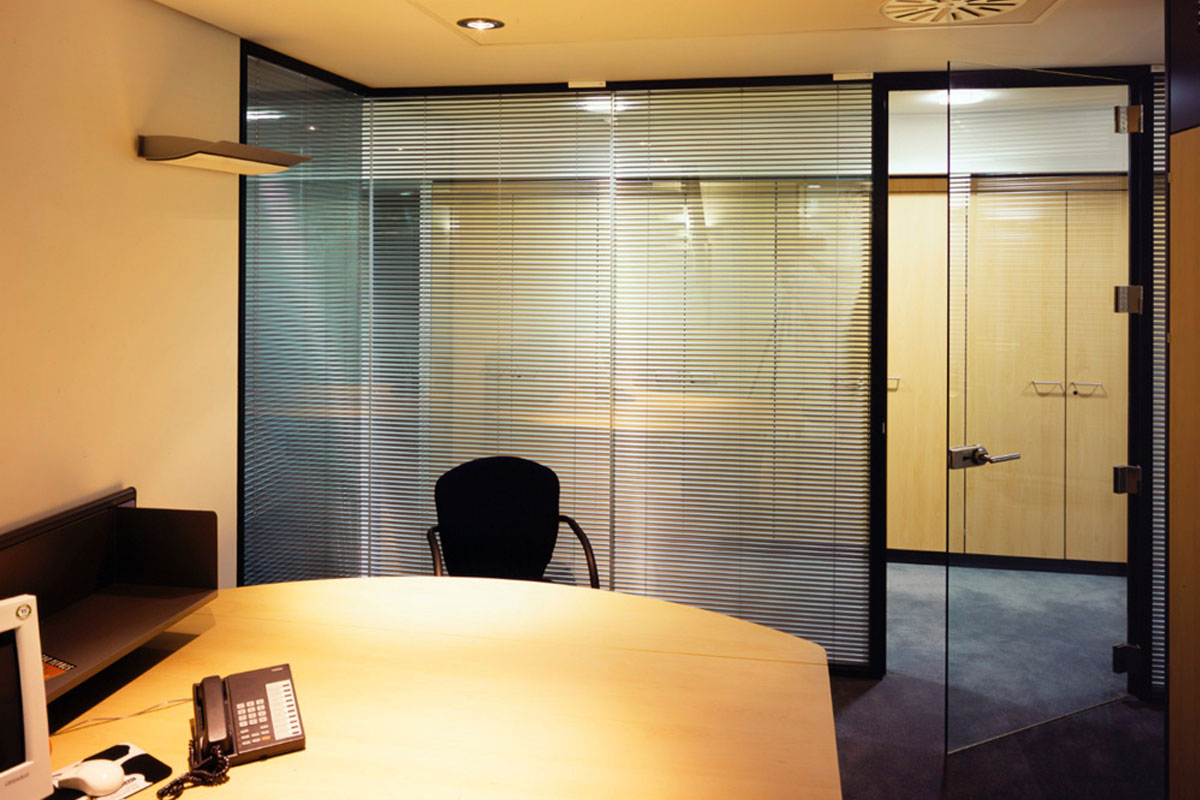 Floor-to-ceiling glass walls with integrated blinds