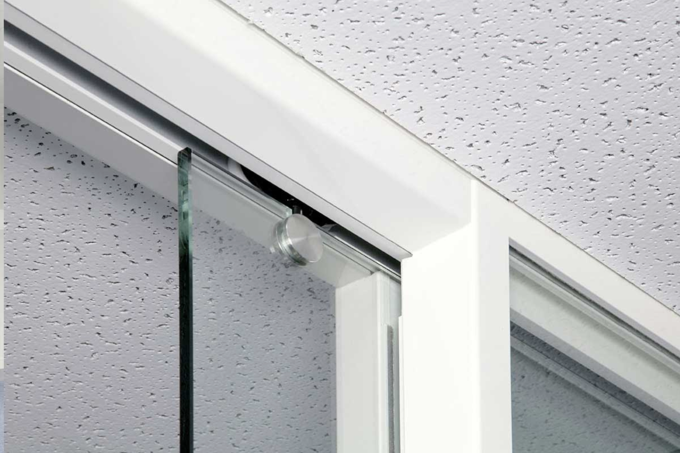 glass pocket door helps to create a peaceful office environment